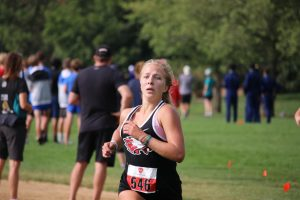 Finishing like she means it, Sophomore Micala Boex pushes to the finish line.