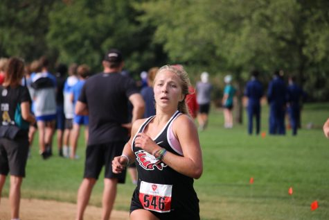 Finishing like she means it, Sophomore Micala Boex pushes to the finish line.