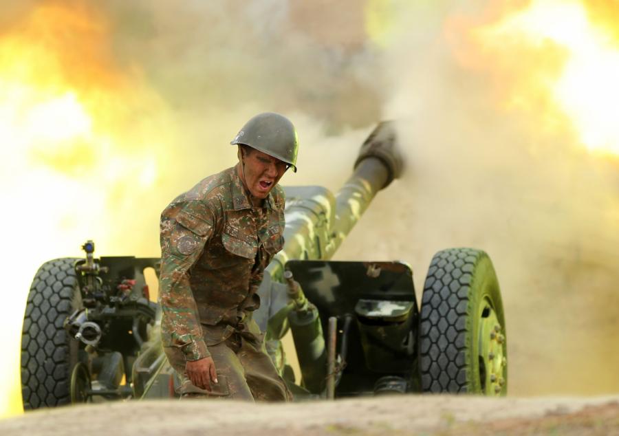 An Armenian soldier firing artillery at  Azeri forces (Image Credit: NYT).