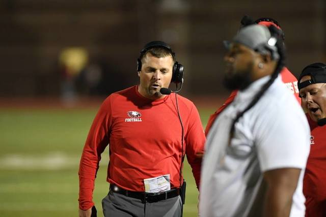 Dustin Delaney pictured as EHS football Coach