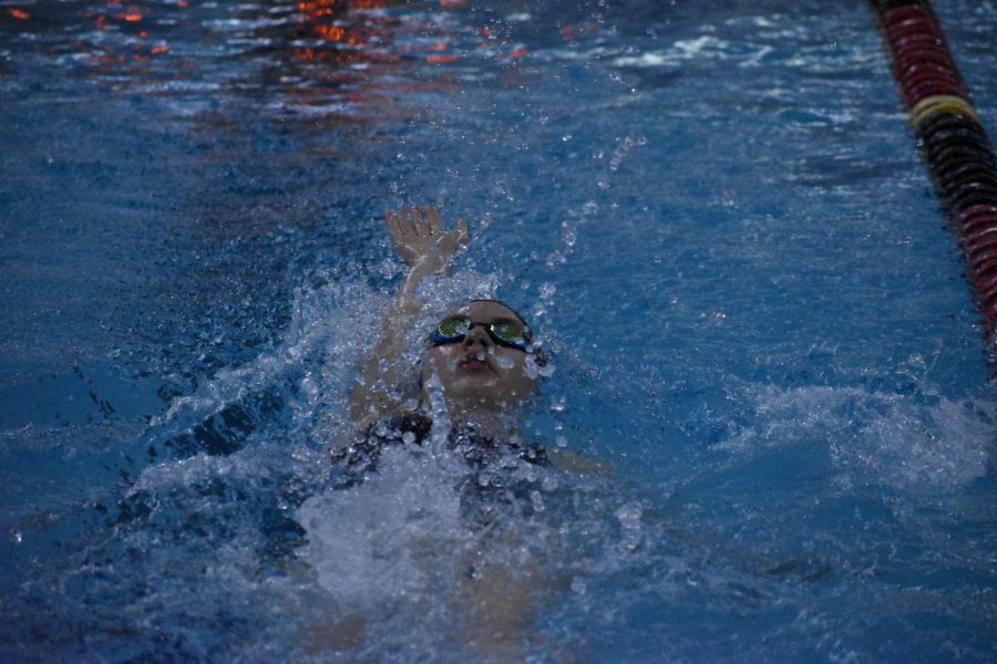 An+EHS+swimmer+pushes+off+the+wall+into+the+final+leg+of+her+100+yard+Backstroke.%0A