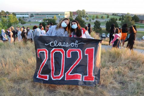 McMillen and Sodhi with a Class of 2021 sign.