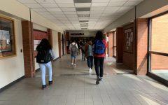 Eaglecrest students walking down the new Covid-19 friendly hallways.