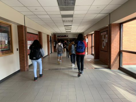Eaglecrest students walking down the new Covid-19 friendly hallways.