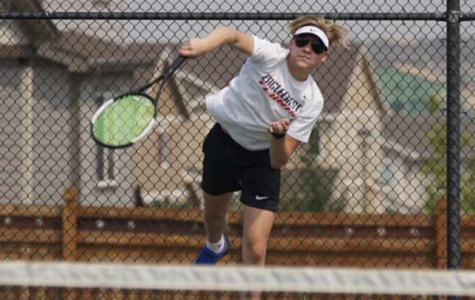Fadem playing tennis at EHS.