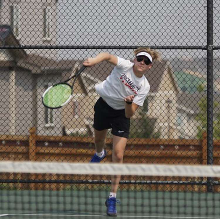 Fadem playing tennis at EHS.