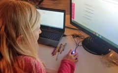 Fourth grader Adelaide Beauchamp works on an online project, engaging in the new, remote form of learning.