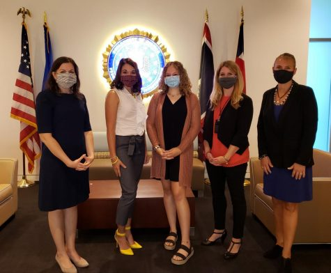 Photo of Kyra Dooley (in the middle) with FBI agents, working together to stop human trafficking (taken by- Leah A. Hapner)