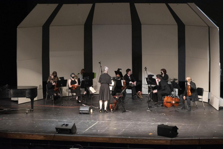 The orchestra, led by Coire Geare and composed of David Chen (Jr.), Bianca Patten (So.), Alex Hull (So.), Kathryn Hotzfeld (So.), Jacob McGuire (So.), Adam McGuire (So.), Ava Cohrs (So.), and Cassandra O'Dell (Jr.) warms up before the show.