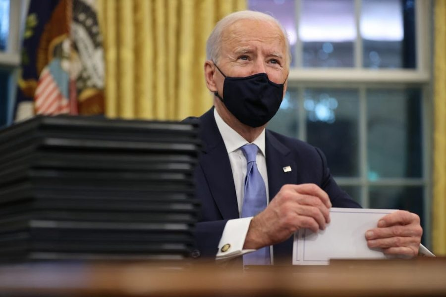 Joe Biden signing executive orders right after his inauguration on January 20th, 2021. Chip Somodevilla/Getty Images