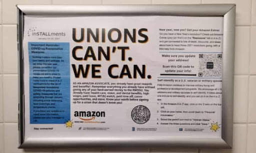 One of several anti-union posters that Amazon placed throughout the Bessemer plant (Credit: The Guardian).