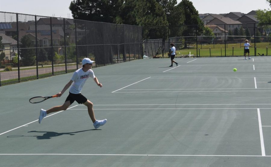 Leif Ritter (Sr.) runs to hit the ball back, racket at the ready.  We have a good senior group, but we also have a lot of returning players which is really helping us, said Coach Palmer. One of his goals is to send multiple players to state, including Ritter.