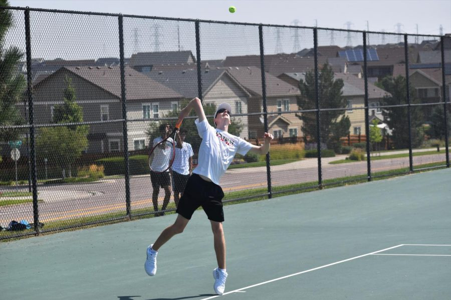 Senior Leif Ritter starts off with a powerful serve against his opponent at Fridays tournament.
