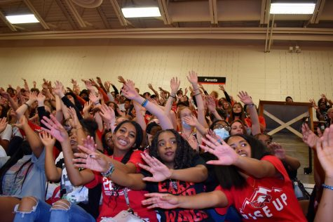Showing the Raptor Spirit: Students in the bleachers participate in games that hype them up for the rally