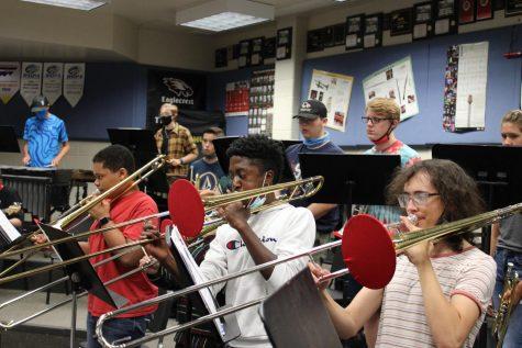 Trombonists (right to left) Naizel Keys-Miller, Jordan Johnson, and Olivia Pierce practice their tunes.